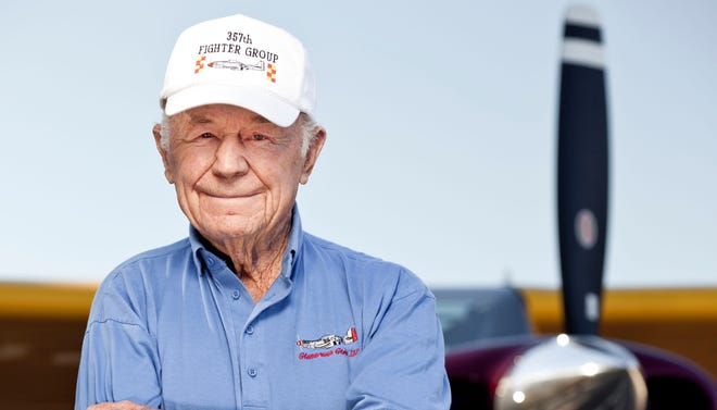 Gen. Chuck Yeager, 89, stands before a prop-driven tail dragger.