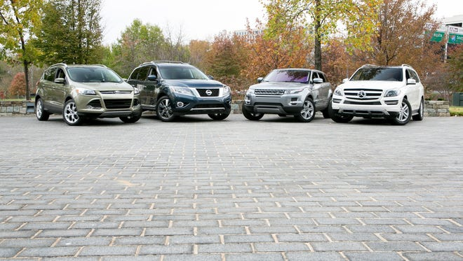 The cars in our Challenge, from left: Ford Escape, Nissan Pathfinder, Range Rover Evoque and Mercedes Benz GL350.