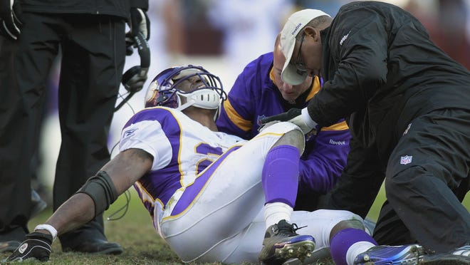 Minnesota Vikings running back Adrian Peterson (28) has returned to full form this NFL season after this devstating knee injury last Dec. 24.