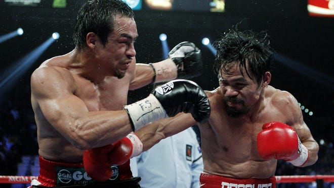 Juan Manuel Marquez, left, went toe-to-toe with  Manny Pacquiao in their third fight in November 2011. Pacquiao won a controversial decision.