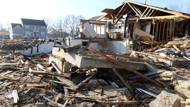 Rubble from a Union Beach, N.J. home destroyed in the wake of Hurricane Sandy litters the area on Dec. 3, 2012.