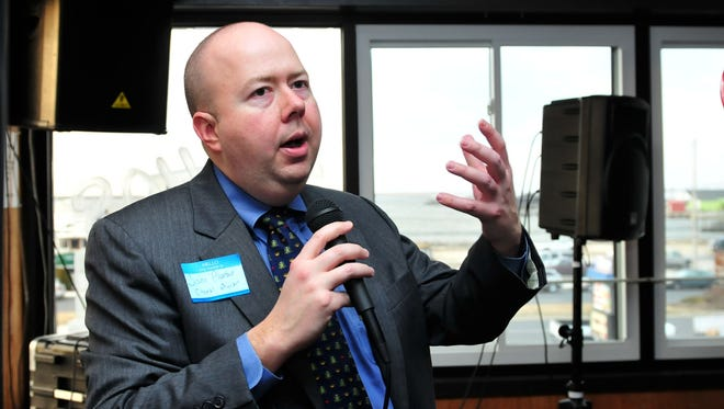 John Phoebus speaks to Chamber of Commerce members during a 2010 meeting.
