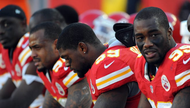 LB Derrick Johnson, left, is among many Chiefs coping with the death of teammate Jovan Belcher (59).