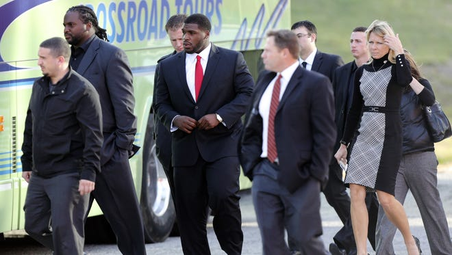 Kansas City Chiefs players and staff leave a memorial service for Jovan Belcher at the Landmark International Deliverance on Dec. 5. Close to a dozen players attended the funeral service for Perkins, who was fatally shot by Belcher before he killed himself.