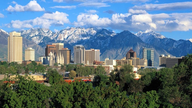 The Salt Lake City skyline showing the Mormon Temple downtown, backed by the Wasatch Mountains in northern Utah.