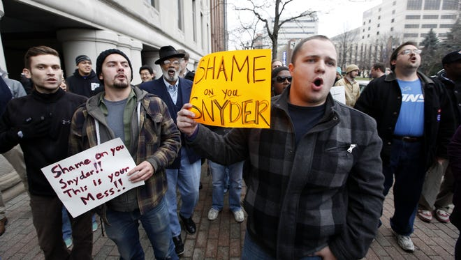 Demonstrators protest right-to-work legislation in the outside the George W. Romney State Office building, where Gov. Snyder's office is located, in Lansing, Mich., Friday, Dec. 7, 2012. Michigan could become the 24th state with a right-to-work law this week.