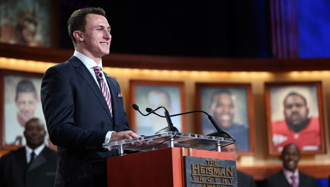 Texas A&M quarterback Johnny Manziel addresses the crowd after being announced the winner of the 2012 Heisman Trophy at the Best Buy Theatre in New York.