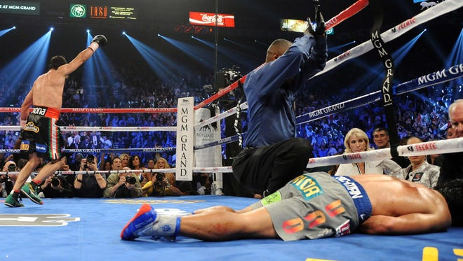Manny Pacquiao on the mat after being knocked out.