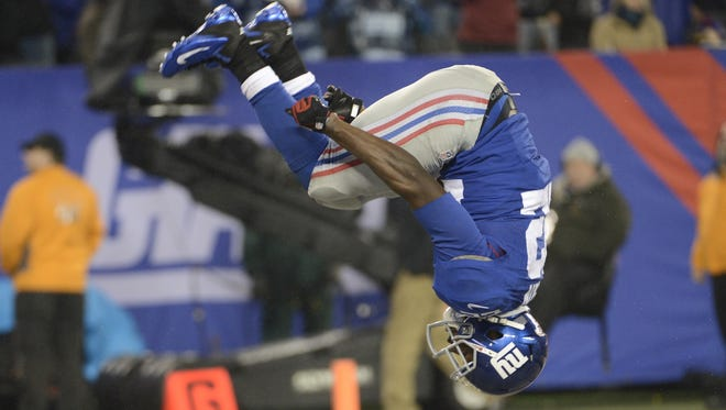 New York Giants running back David Wilson (22) does another flip after scoring a second-half touchdown