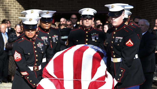 U.S. Marine pallbearers carry a casket containing the body of Cpl. Christopher  Monahan Jr. in Bayville, N.J., on Dec. 6.  Monahan died Nov. 26 in Helmand province in Afghanistan.