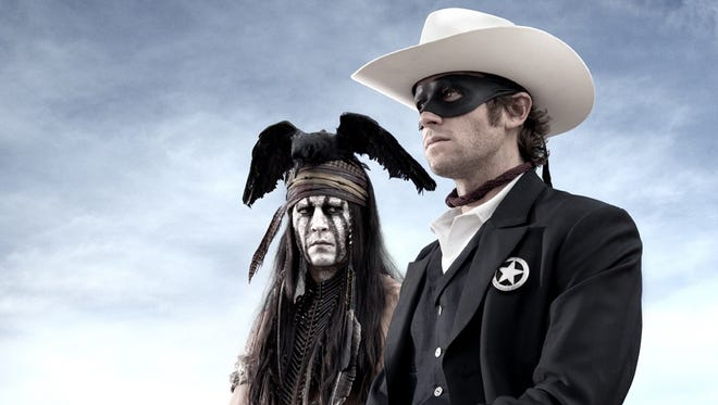 Tonto (Johnny Depp, left) joins forces in a fight for justice with John Reid (Armie Hammer)  a lawman who has become a masked avenger.