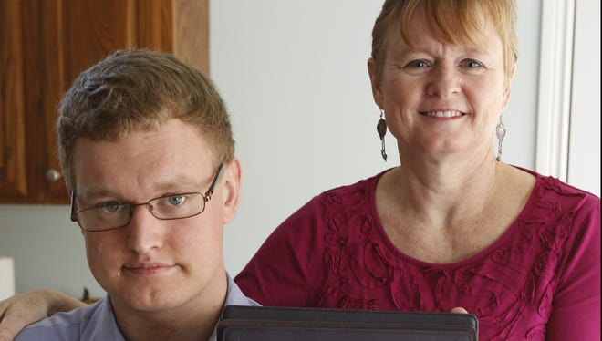 Inspired by her 21-year-old son, Jack, Therese Wantuch of Mount Washington, Ohio, created Training Faces, an app designed to help people with Autism, Asperger's Syndrome and other special needs with emotion recognition. The Wantuchs display the app on Monday, Nov. 19, 2012.