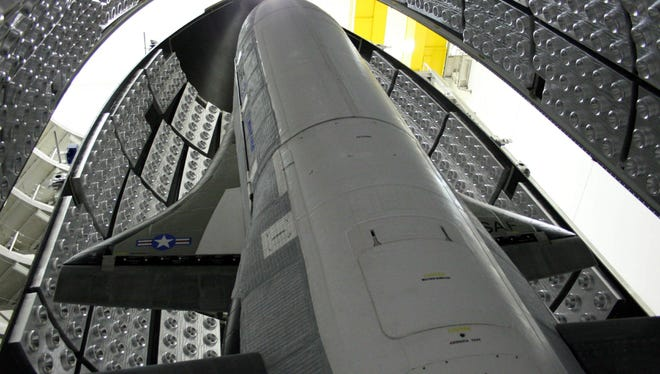 The X-37B Orbital Test Vehicle in the encapsulation cell at the Astrotech facility in April 2010, in Titusville, Fla. Air Force officials are scheduled to launch the third X-37B mission Tuesday, Dec. 11, 2012. Photo courtesy of the U.S. Air Force.