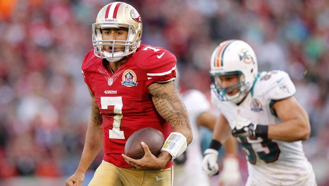 49ers quarterback Colin Kaepernick (7) runs for a 50-yard touchdown against the Dolphins in the fourth quarter at Candlestick Park.