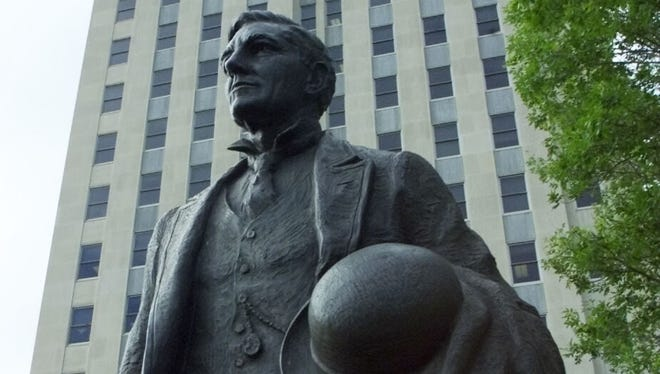 A statue of John  Burke, a former North Dakota governor, in front of the state Capitol building in  Bismarck.