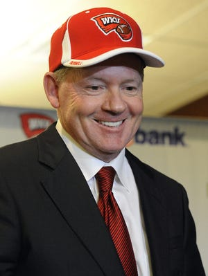 New Western Kentucky head coach Bobby Petrino smiles during an NCAA college football news conference, Monday, Dec. 10, 2012, in Bowling Green, Ky.