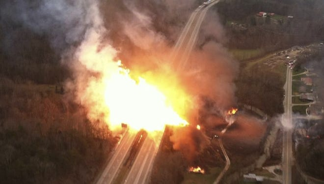 A fireball erupted across Interstate 77 from a gas line explosion in Sissonville, W. Va. on Tuesday.