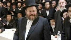 This May 16 image taken from video provided by WCBS-TV, shows Nechemya Weberman attending a fundraiser in his behalf in Brooklyn.