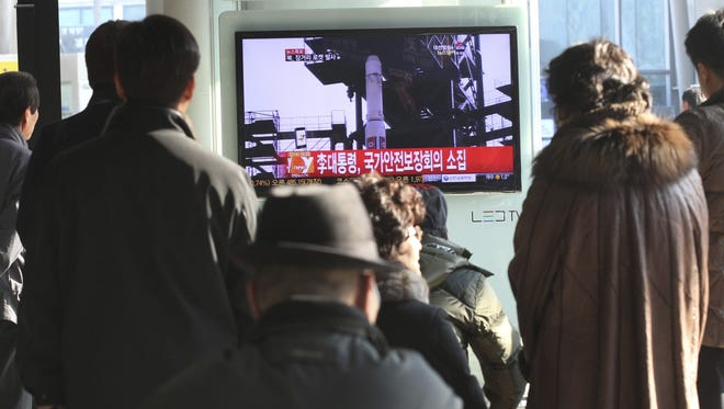South Koreans watch public TV reporting news about North Korea's rocket launch at Seoul Railway Station in South Korea on Wednesday.