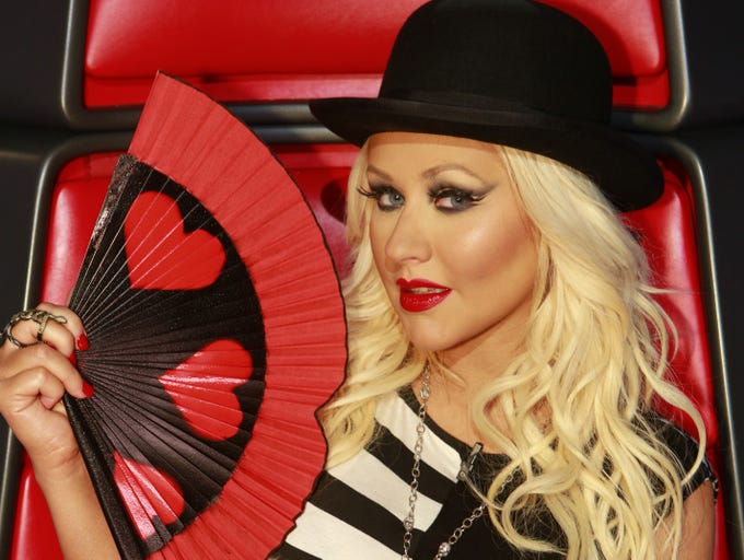 "If you're a fan of 'The Voice,' then you know that mentor Christina Aguilera does a lot of self-fanning. USA TODAY's Carly Mallenbaum takes a look at the many hand fans (and hairdos) of Xtina. The diva ""hearts"" her fans, for sure!"