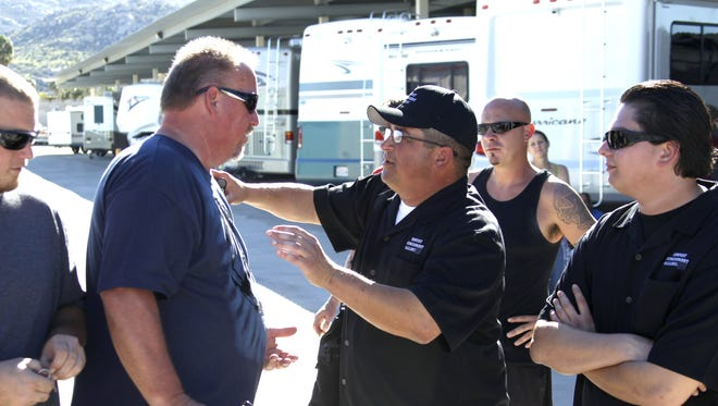 Bidders and cast members Darrell Sheets, left, and Dave Hester argue after the final auction at Freedom Storage in Homeland, Calif., in 2011.