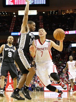 Rockets point guard Jeremy Lin drives on Spurs guard Gary Neal during San Antonio's 134-126 loss Monday.