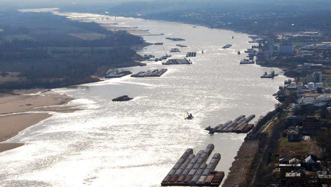 Barges pass in tight quarters due to low water levels as they navigate the Mississippi River near St. Louis last week.