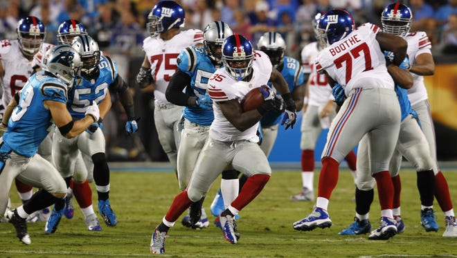 New York Giants' Andre Brown (35) runs against the Carolina Panthers during the first quarter of a Thursday night NFL game in September. The league expanded its Thursday slate this season to include every team in a game, but some players and coaches say the turnaround to play four days after a Sunday game hurts recovery and preparation time.