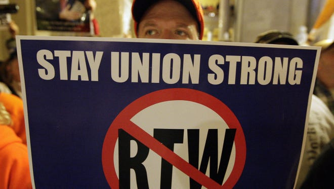 Indiana, where Charles Cain of Columbus, Ind., protested impending right-to-work legislation in January, was the first of the traditional Rust Belt states to limit union bargaining powers.