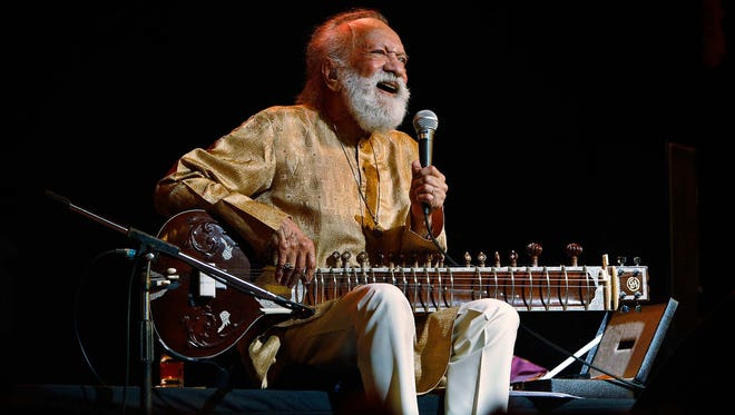 Ravi Shankar laughs during a concert on Feb. 7 in Bangalore, India.