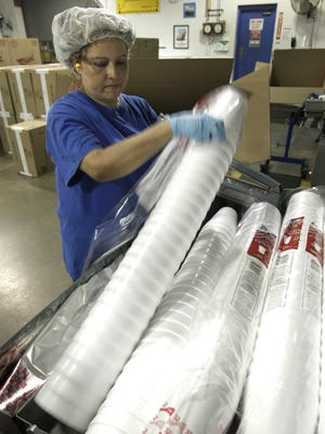 Polystyrene cups are bagged after being manufactured at the DART Container Corp. plant in Lodi, Calif., on July 28, 2011.  More U.S. cities are banning or restricting foam cups and take-out food containers, but critics say the alternatives may not be better.