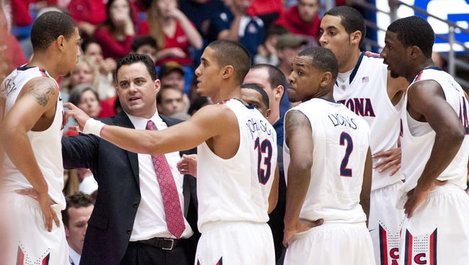 Arizona coach Sean Miller directs his players in a huddle with forward Brandon Ashley (21), guard Nick Johnson (13), guard Mark Lyons (2), forward Grant Jerrett (33) and forward Solomon Hill (44) during the second half of a win against Long Beach State last month.