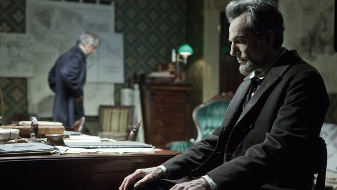 President Lincoln (Daniel Day-Lewis) confers with his secretary of state, William H. Seward (David Strathairn), in 'Lincoln.'
