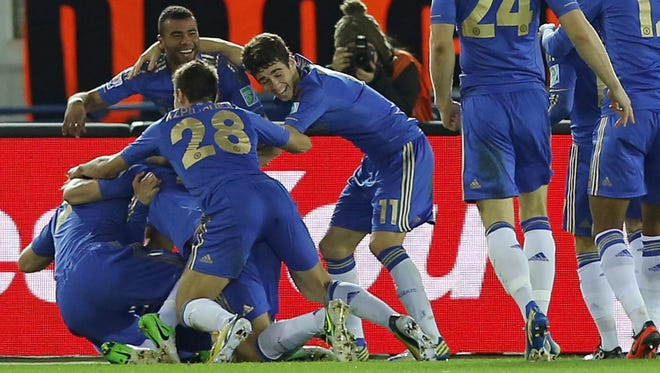 Chelsea's Fernando Torres is mobbed by teammates after scoring a goal that gave Chelsea a 2-0 lead.