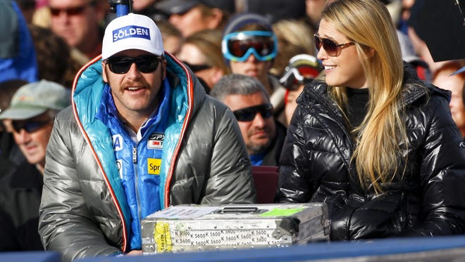 Bode Miller and his wife Morgan watch the competition in the finish area at the men's World Cup downhill ski race in Beaver Creek, Colo., on Nov. 30.