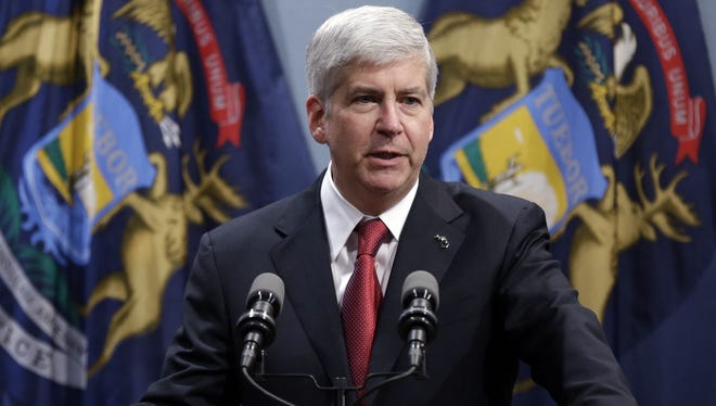 Michigan Republican Gov. Rick Snyder has taken heat from both sides since he signed a measure limiting the power of unions.