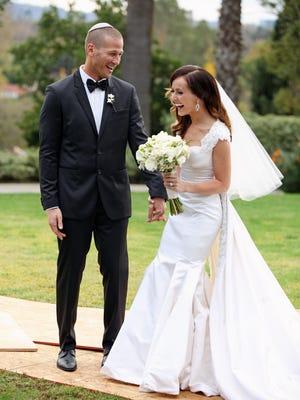 Ashley Hebert and J.P. Rosenbaum smile on their Dec. 1 wedding day.