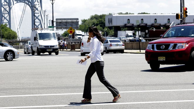 A Fort Lee, N.J., ordinance makes it illegal for pedestrians to use a handheld device while crossing intersections.