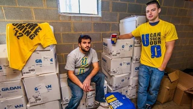 Adam Bloom (left) and Ben Goodman have sued the University of Delaware, which stopped the two students from selling 2, 000 T-shirts and other items during homecoming, citing copyright infringement of the school's logo. (Robert Craig/The (Wilmington, Del.) News Journal)