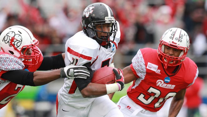 Valdosta State Blazers running back Cedric O'Neal (7)  carries the ball against Winston-Salem State Rams during the NCAA division II football Championship at Braly Stadium.
