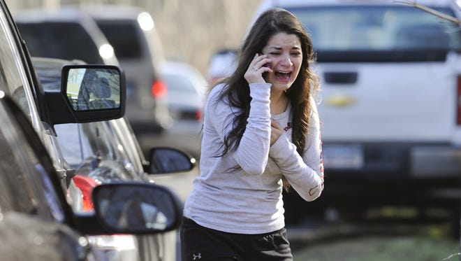 Jillian Soto waits to hear about her sister, a teacher, after the shooting.
