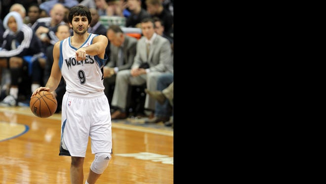 Timberwolves guard Ricky Rubio smiles during his first game back from reconstructive knee surgery Saturday against the Mavericks.