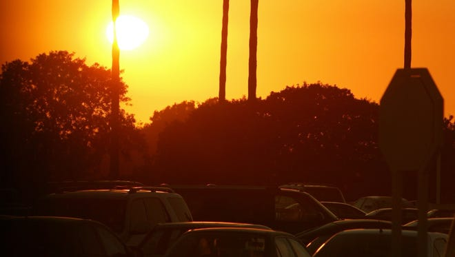 A sunset at the Fashion Island mall parking lot in Newport Beach, Calif..