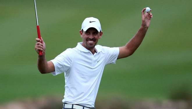 Charl Schwartzel of South Africa celebrates after winning the Alfred Dunhill Championship on Sunday in Malelane, South Africa.
