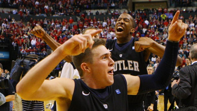 Butler Bulldogs guard Rotnei Clarke (15) and forward Khyle Marshall (21) celebrate the victory over the Indiana Hoosiers at Bankers Life Fieldhouse. Butler defeated Indiana in overtime 88-86.