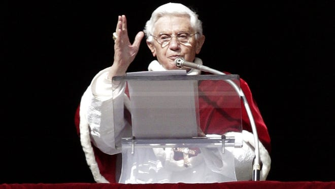 Pope Benedict XVI delivers his blessing during the Angelus prayer from his studio overlooking St. Peter's Square at the Vatican, Sunday.
