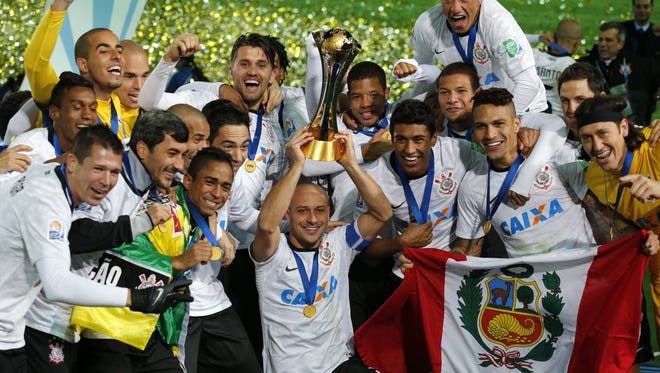 Corinthians' Corinthians' Alessandro holds up the trophy with teammates after beating Chelsea FC, 1-0, during the final of the FIFA Club World Cup soccer tournament in Yokohama, near Tokyo, Sunday, Dec. 16, 2012.