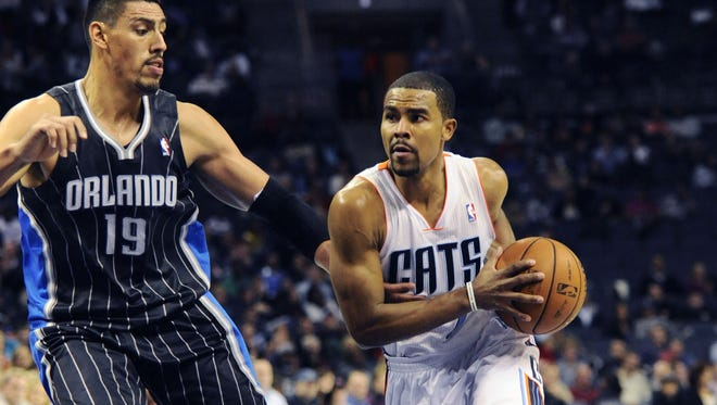 Charlotte Bobcats guard Ramon Sessions (7) drives down the court as he is defended by Orlando Magic forward center Gustavo Ayon (19) in the Magic's win on Saturday.