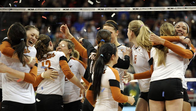 Texas players celebrate after sweeping Oregon to win the NCAA volleyball championship.