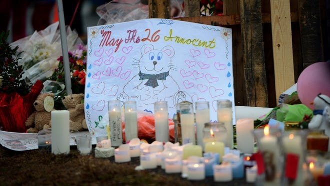 A sign is seen at a makeshift shrine to the victims of the Sandy Hook Elementary School shooting in Newtown, Conn.